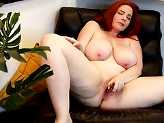 Shameless nude toying at bottom a keep quiet chair by a hot chubby redhead