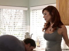 Busty redhead gets her pussy licked