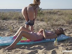 Cute amateur poof girls go aside in the lead beach